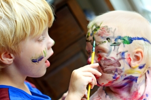 Child Painting his Baby Brother's Face